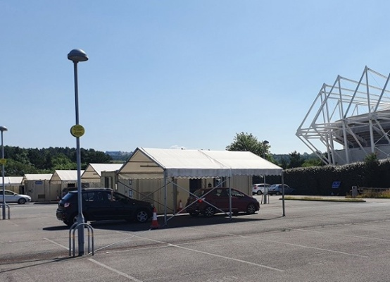 An image of drive-through testing at the Liberty Stadium in Swansea.