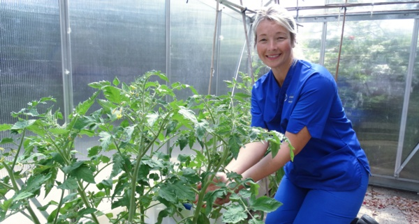 Lisa Davies in the greenhouse
