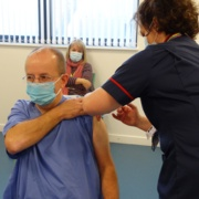Geraint Jenkins receives the vaccine from a nurse