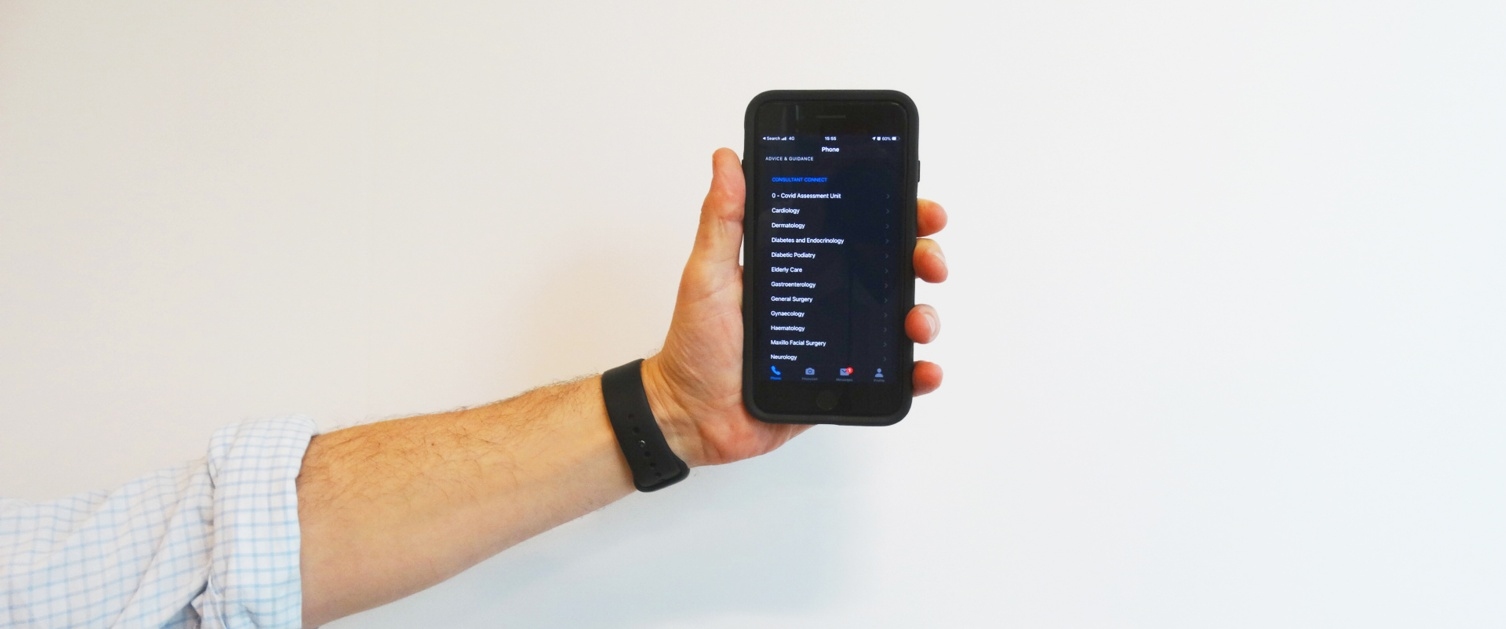 Hand holding phone displaying Consultant Connect