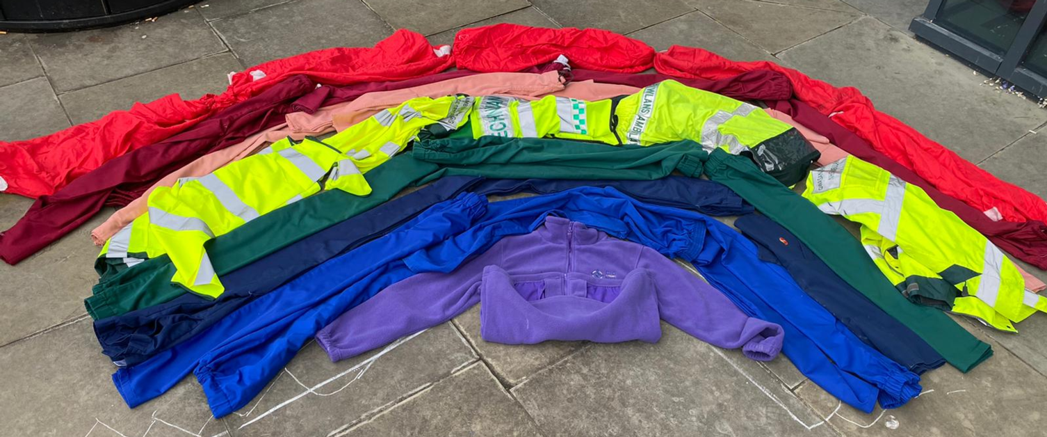 An image of a rainbow created by NHS uniforms
