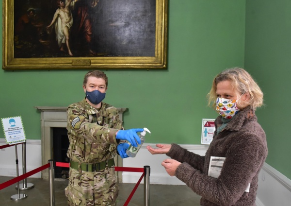 Anthony McCarthy dispensing hand sanitiser.