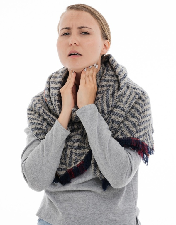 A picture of a woman with a sore throat