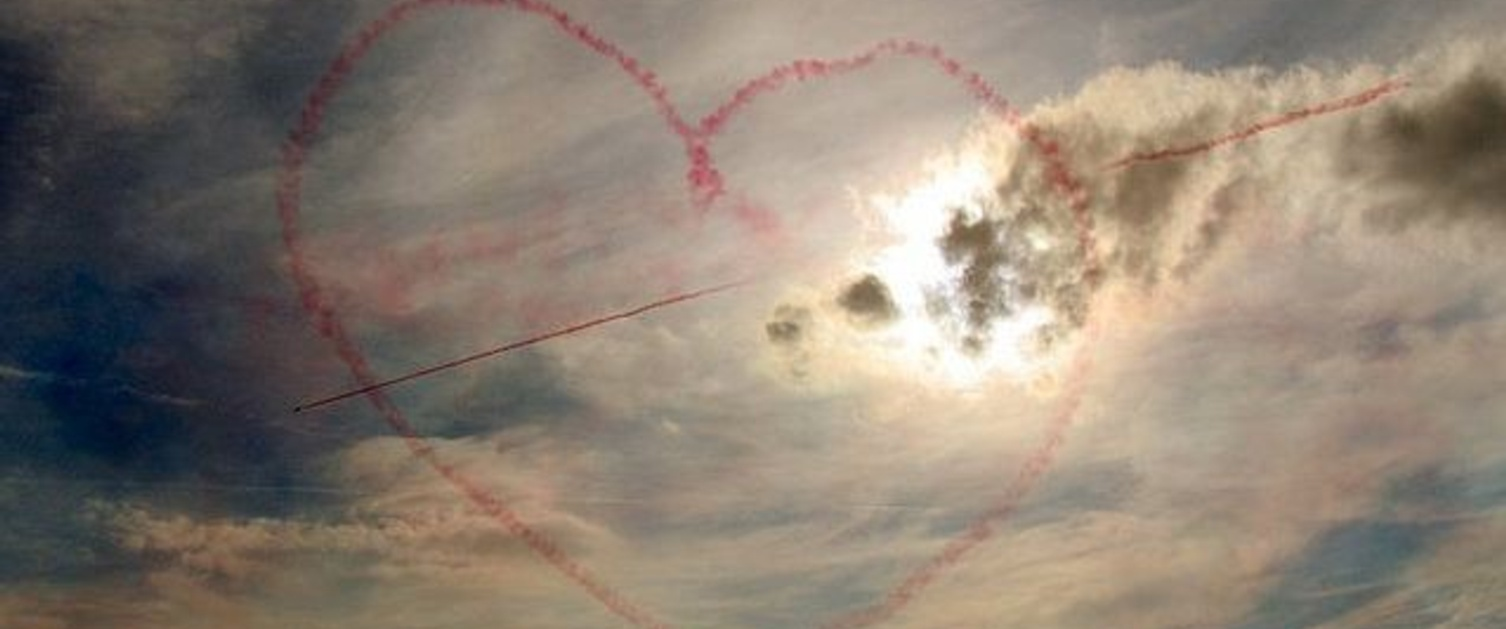 An image of the sky with a red heart in it