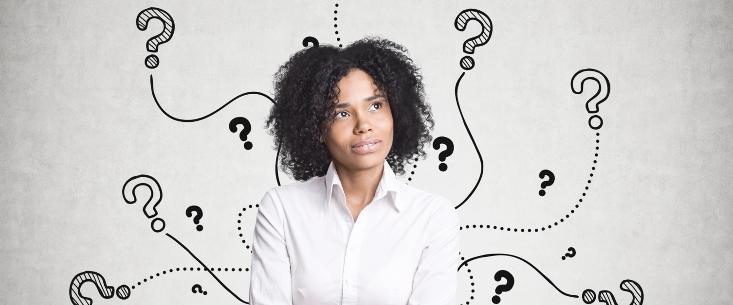 A woman with black afro hair, wearing a white shirt, looks thought. She is surrounded by illustrated question marks.