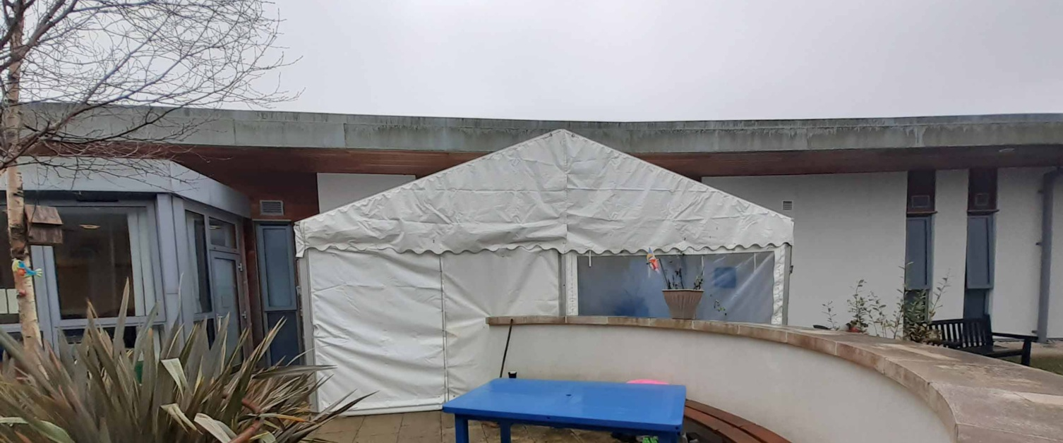 A large white marquee is shown in the courtyard of Ysbryd Y Coed.