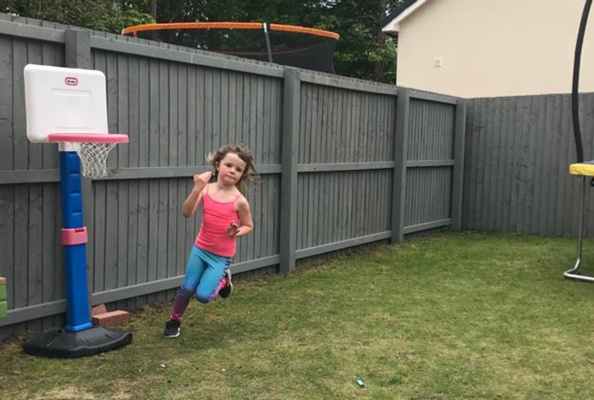 Penny Seager-Davies, a young girl running a marathon in her garden to raise money for the NHS