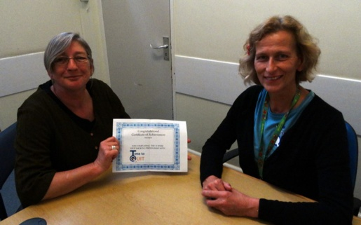 Kelly Wearing receives her certificate of achievement for being 12 weeks smoke free from smoking cessation counsellor Diana Green.
