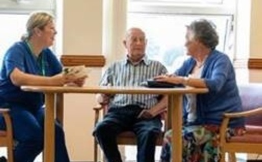 An image of patients talking to a nurse