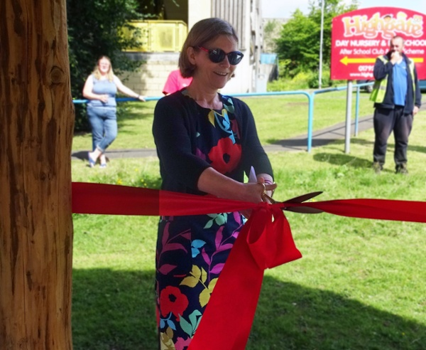 Woman cutting a ribbon