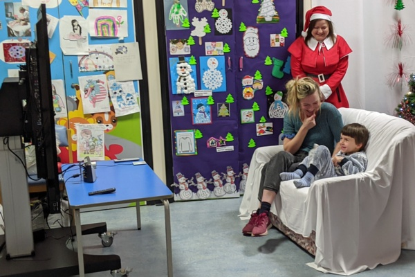 Yanni and mum Pearl speak to Santa using a webcam and television in Ward M's playroom.