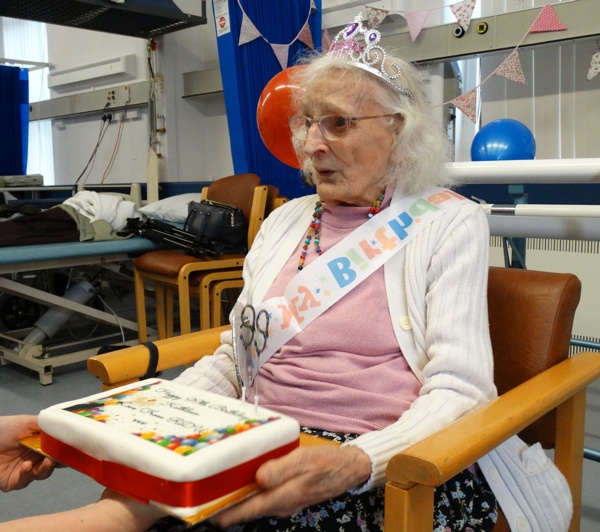 Kathleen Davies, 99, is presented with her birthday cake