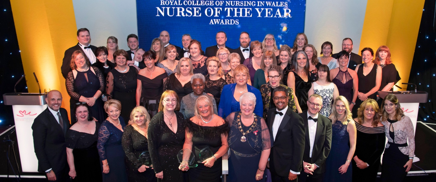 All of the RCN Wales Nurse of the Year winners are pictured together in front of a blue banner.