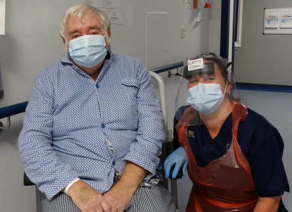 Image shows patient Danny Egan in a wheelchair next to Sister Kirsty Hopkins