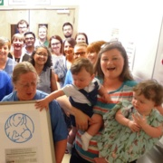 Ollie Rees, 13 months, gets his hand on the UNICEF award.