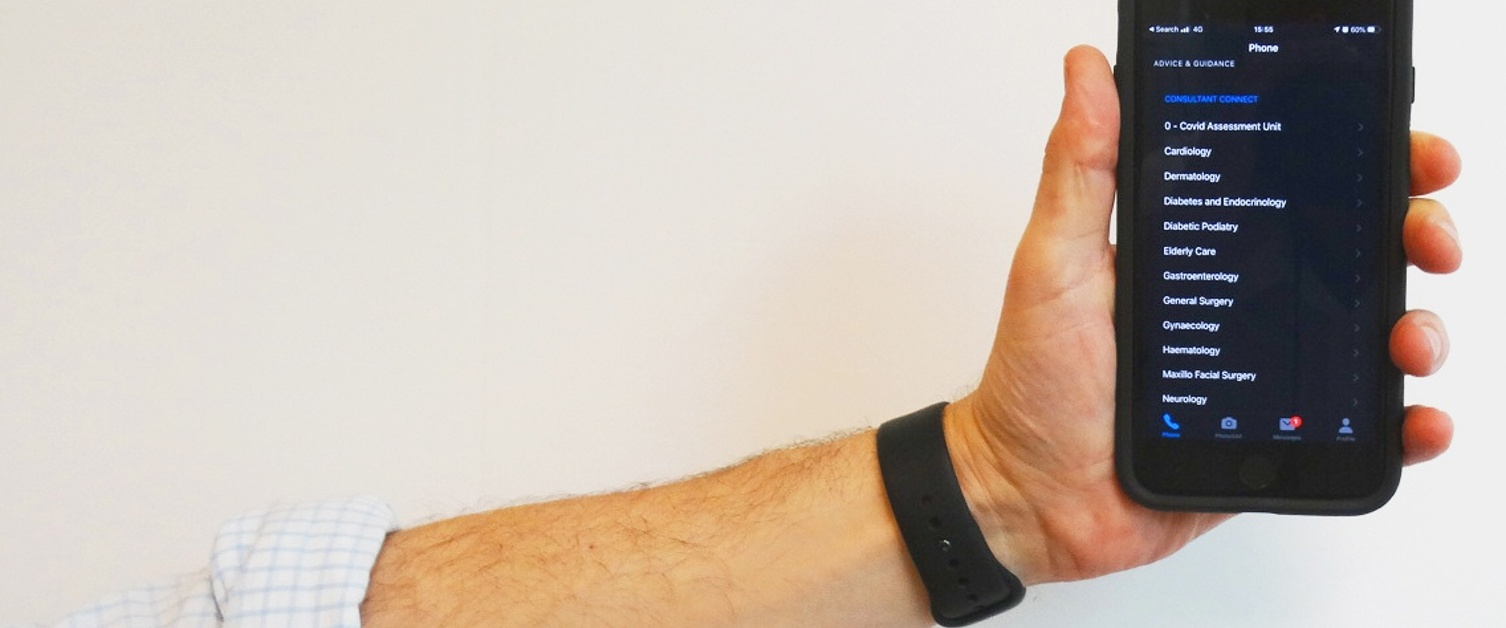 Hand holding a phone displaying the Consultant Connect app
