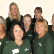 A group of women smiling together - Macmillan Cancer Support Team