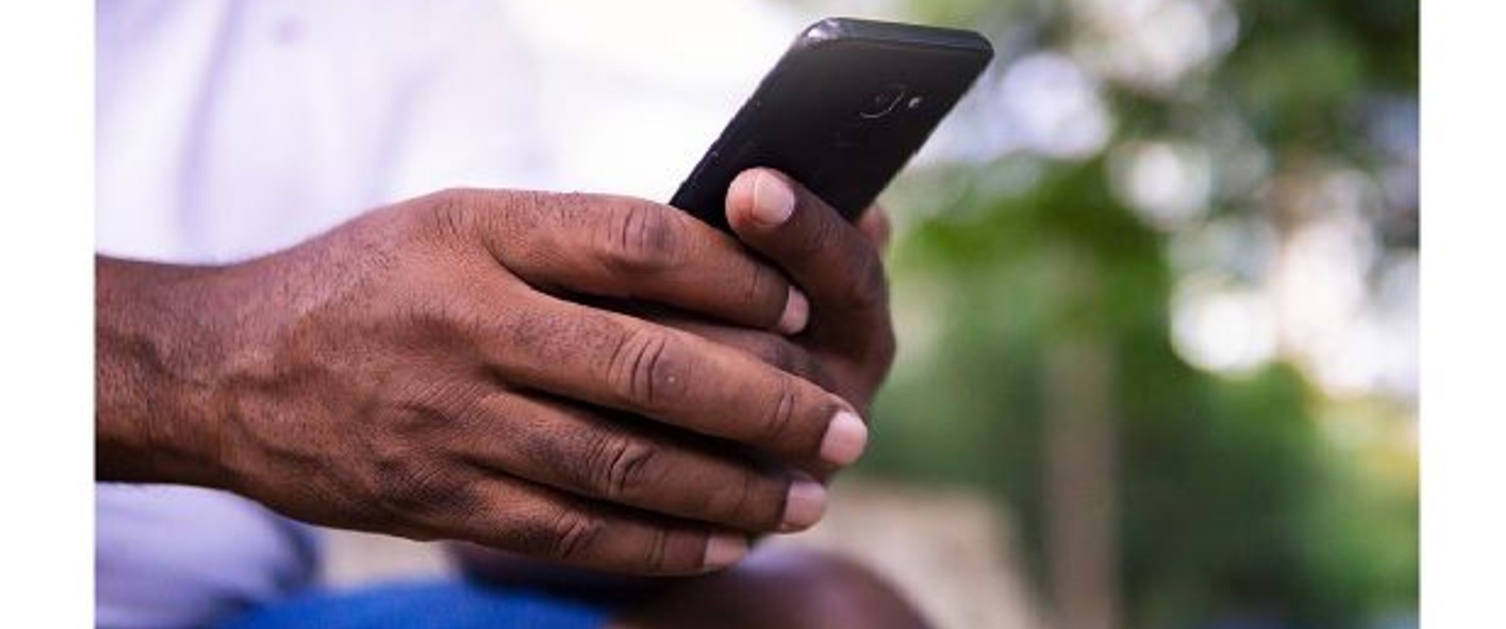 An image of hands holding a phone