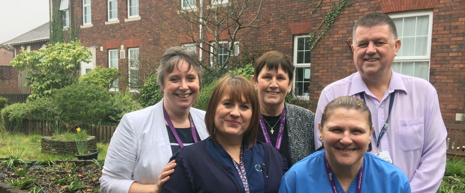 Staff in the garden at Gorseinon Hospital