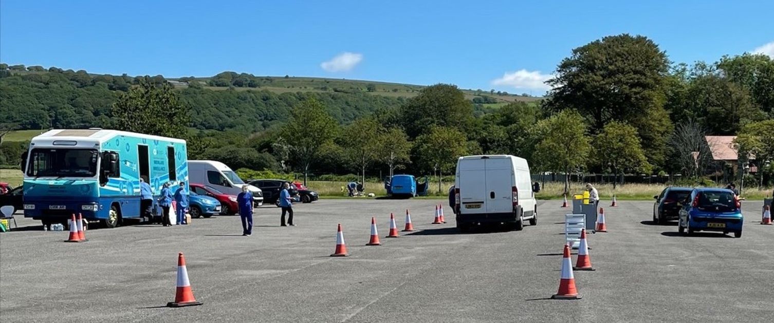 A folding sign marks lane one of the drive-through session set up at Margam Park's east lodge car park.