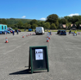 A folding sign marks lane one of the drive-through session set up at Margam Park