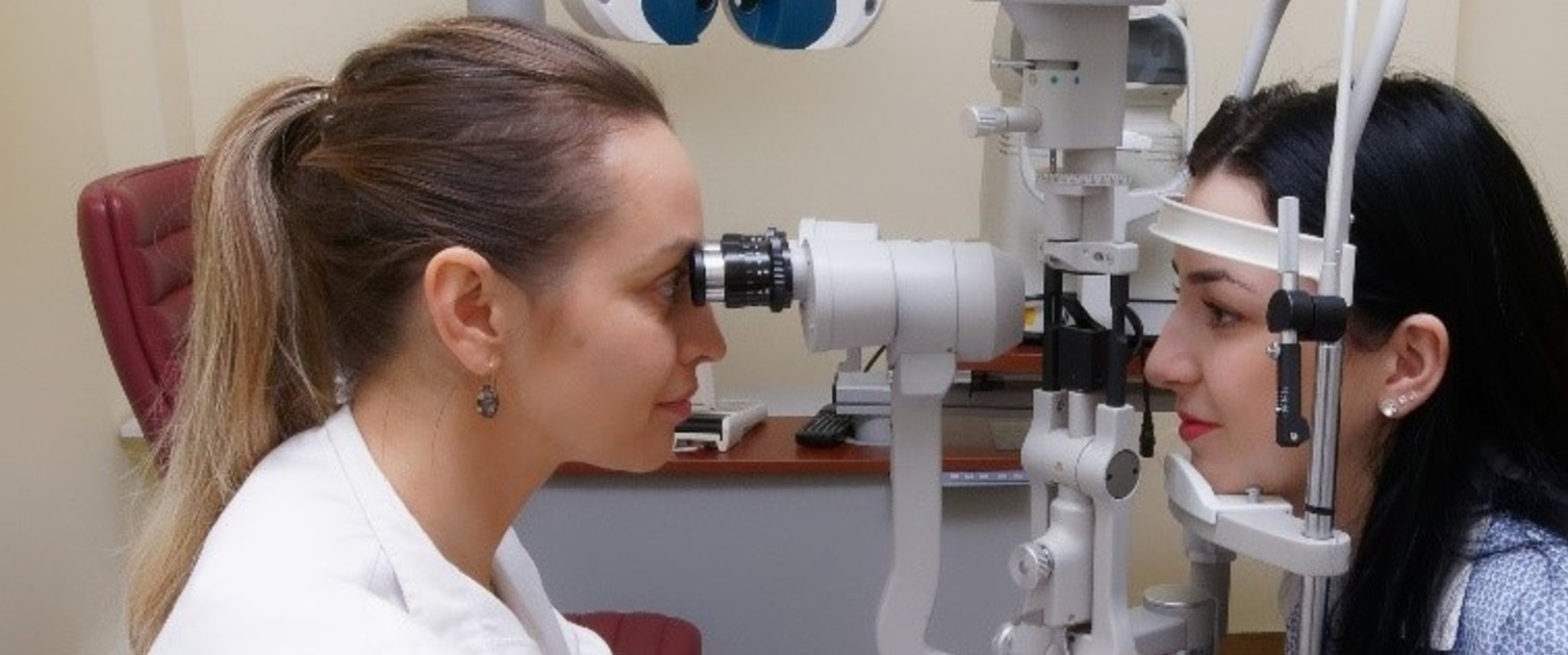 An image of a consultant examining a patient's eyes.