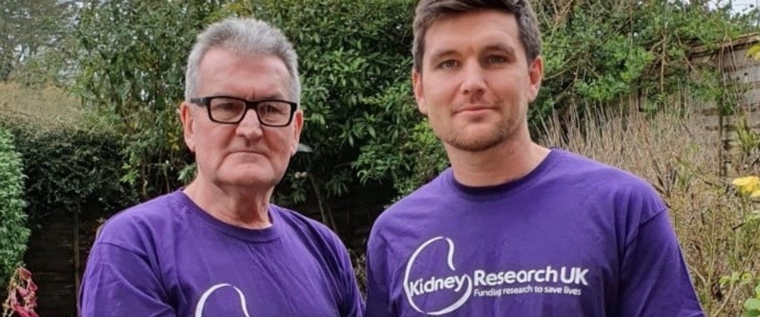 Geoff Walker, activities coordinator at Caswell Clinic with son Andy, wearing purple Kidney Research UK t-shirts.