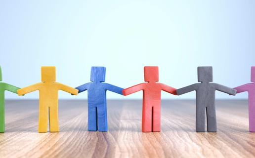 An image of figures holding hands to represent a community
