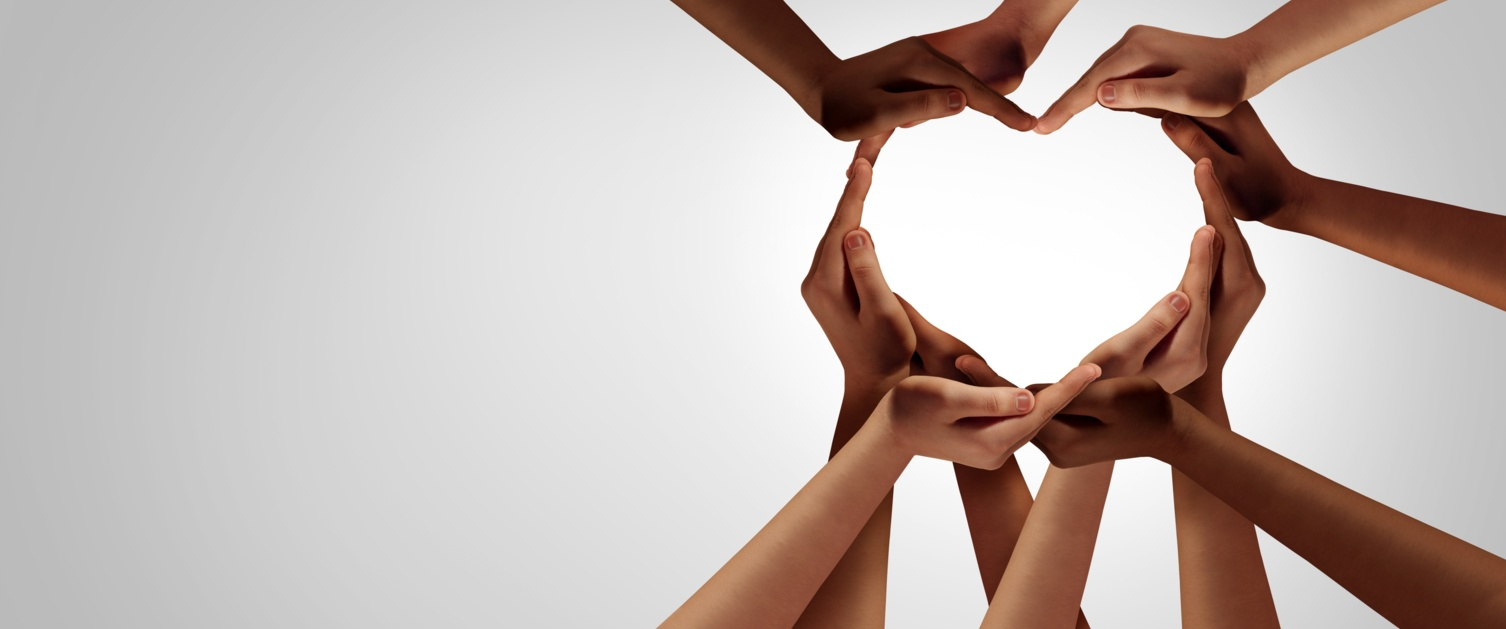 Various hands forming a heart shape