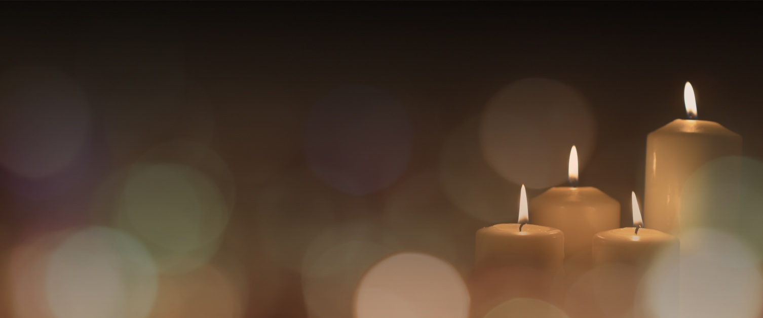 An image of three memorial candles