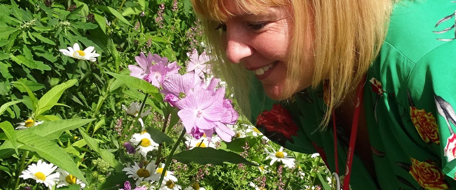 Woman enjoying scent of wild flowers