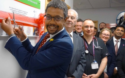 Health Minister Vaughan Gething smiling with members of staff opening a new centre at Morriston.