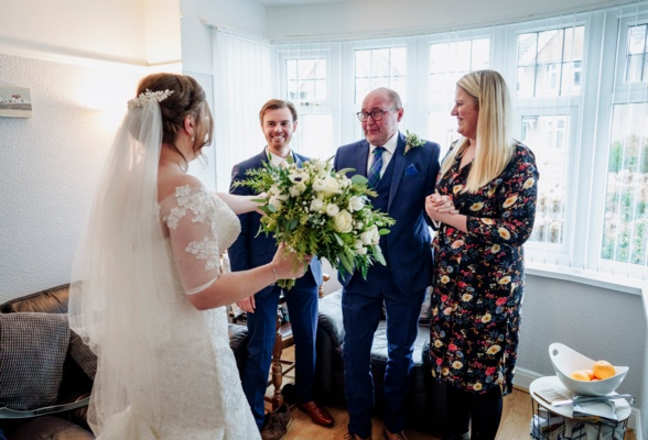 Bride and people in house