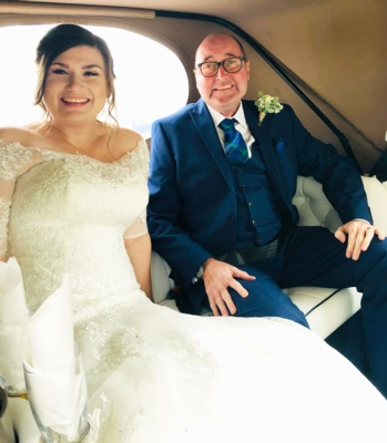Bride and man in car