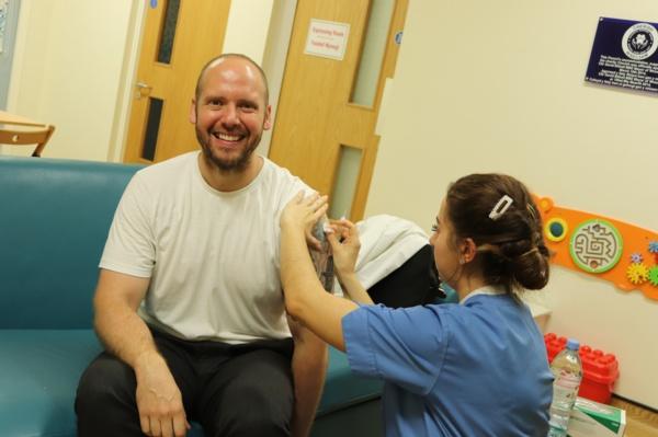 Patient receives flu vaccine from BCUHB nurse