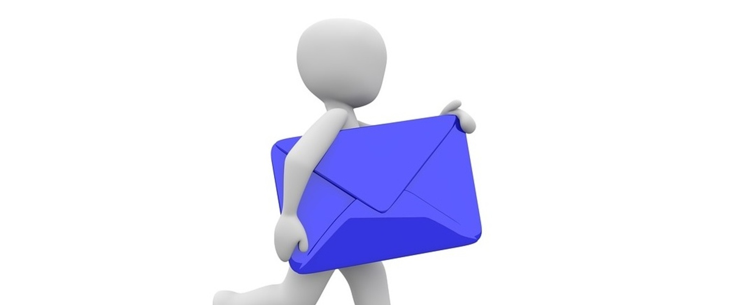 Person holding blue envelope