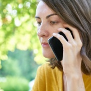 Woman Holding Smartphone making a call