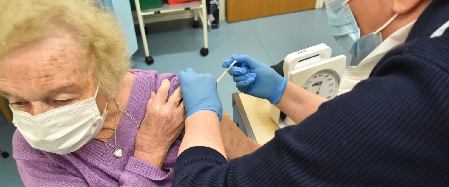 A lady receives the COVID-19 vaccination at a GP practice