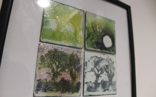 A painting of four pieces depicting nature in four seasons