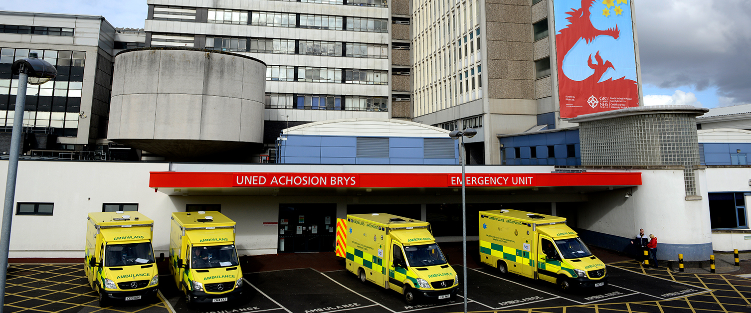 An image of ambulances outside the Emergency Unit at the University Hospital for Wales
