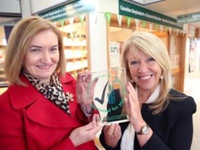 Susan Morris andMaria Battle with award