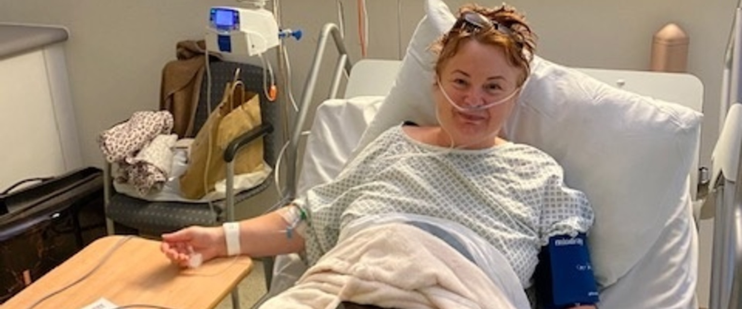 Melanie James in a hospital bed