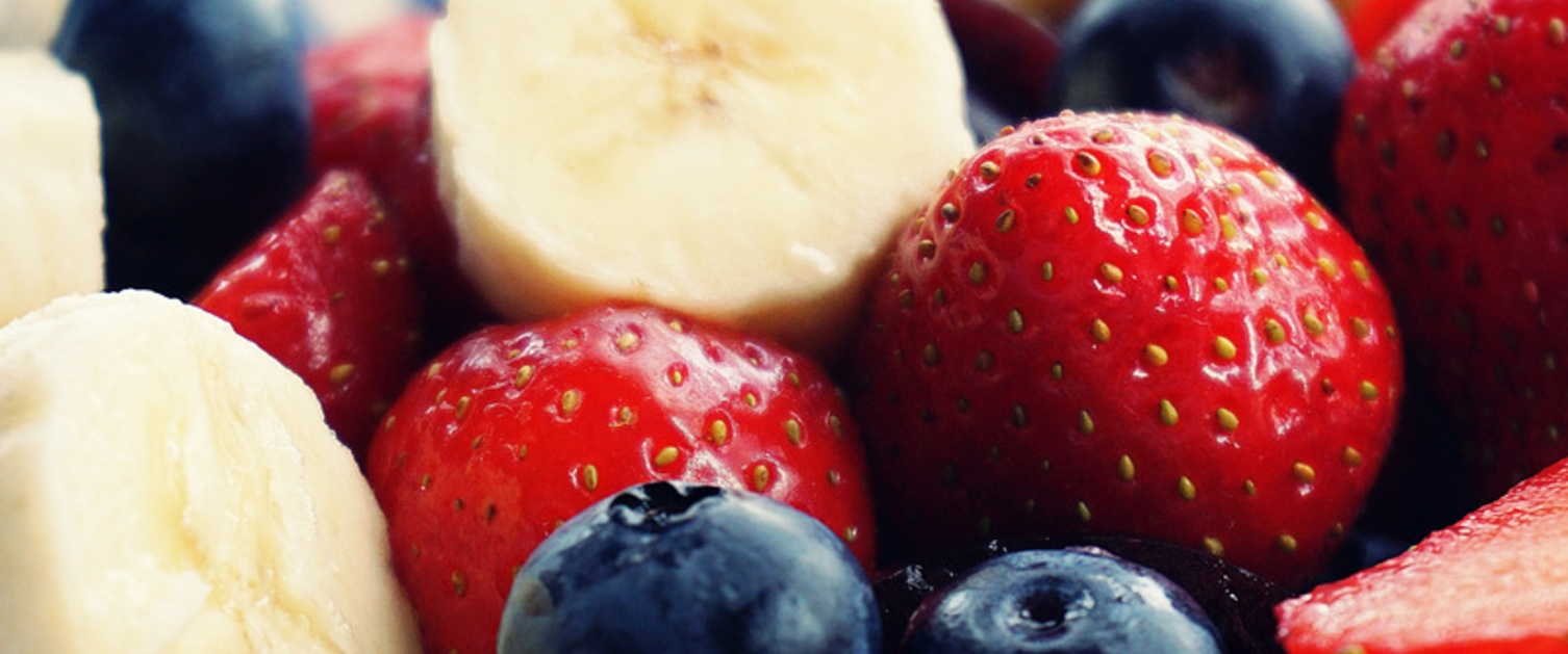 Sliced Banana, strawberries and blackberries