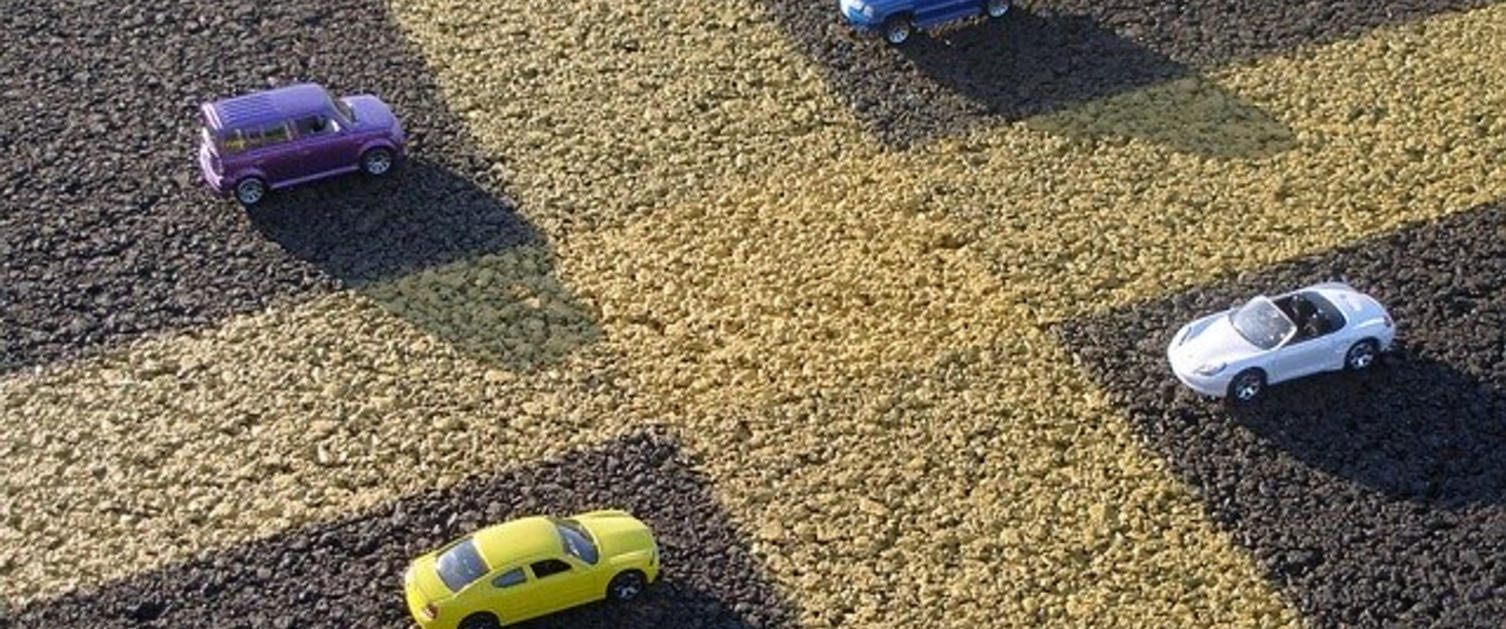 Toy cars in parking spaces
