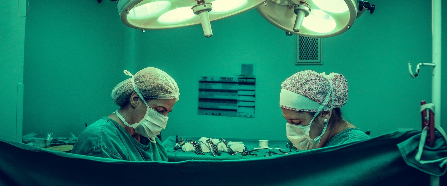 Two people performing a surgery