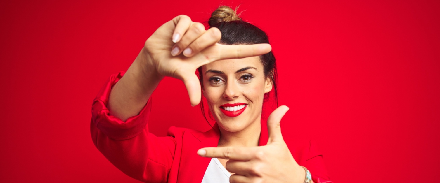 Woman smiling on a red background