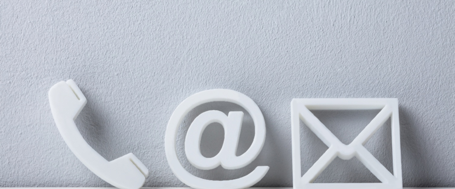 Icons of a phone, email and letter