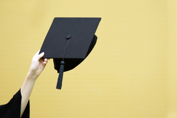 Graduate cap on yellow background<br>