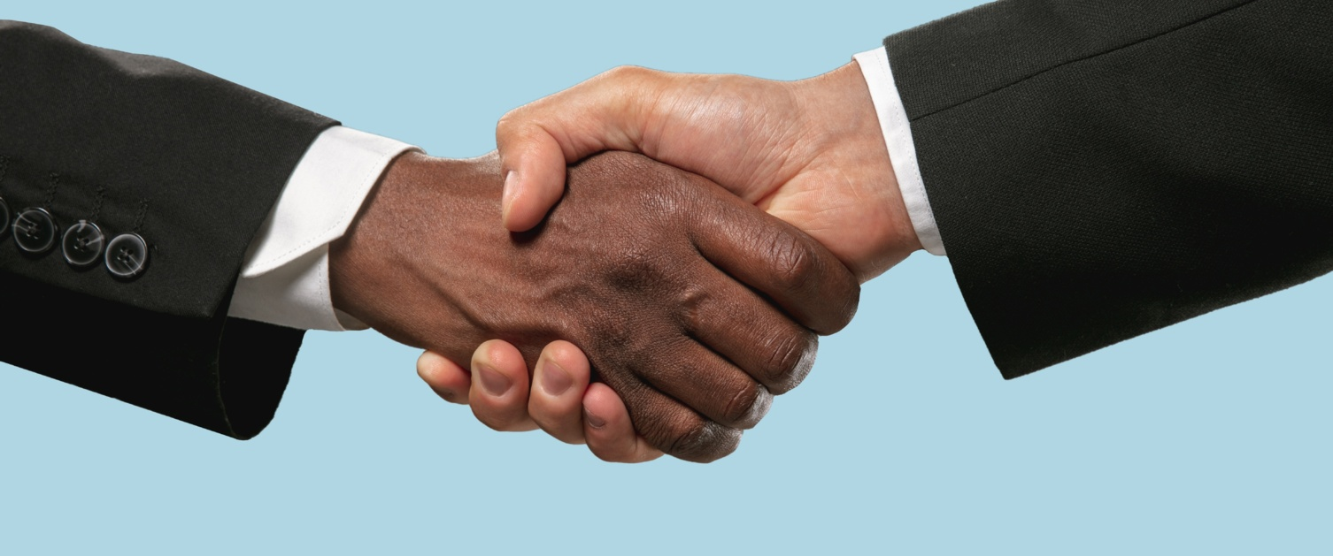 Handshake on blue background