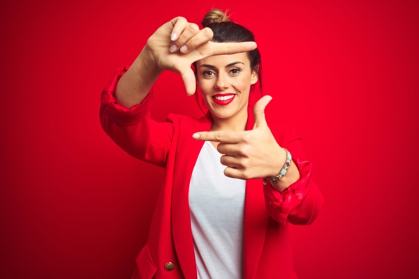 Woman smiling on a red background<br>